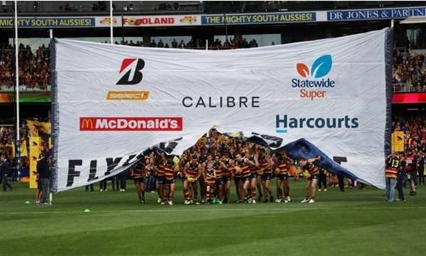 Harcourts logo on Crows banner