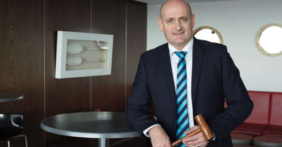 Andrew de Bomford from Harcourts Burnie winning the REIT Auction Competition.jpg