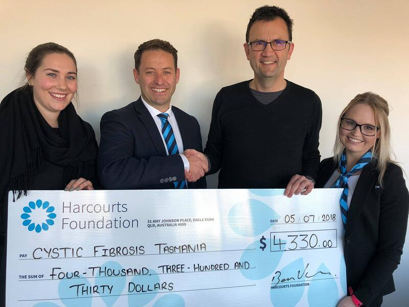 Ben Vance (Harcourts Hobart) with Corrine Eastwood and Amanda Brooks to Scott Lancaster of CFT